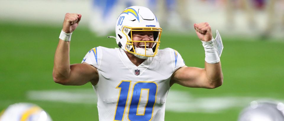 Dec 17, 2020; Paradise, Nevada, USA; Los Angeles Chargers quarterback Justin Herbert (10) celebrates the touchdown scored by running back Kalen Ballage (31) against the Las Vegas Raiders during the second half at Allegiant Stadium. Mandatory Credit: Mark J. Rebilas-USA TODAY Sports via Reuters