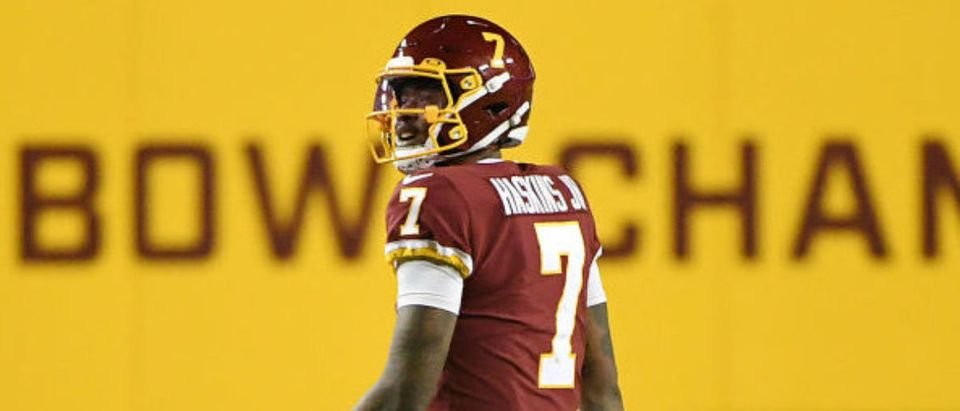 LANDOVER, MARYLAND - DECEMBER 27: Dwayne Haskins #7 of the Washington Football Team reacts against the Carolina Panthers during the fourth quarter at FedExField on December 27, 2020 in Landover, Maryland. (Photo by Will Newton/Getty Images)