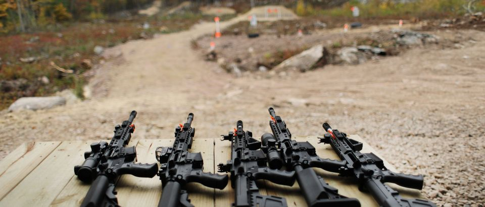 "GREELEY, PENNSYLVANIA - OCTOBER 12: AR-15 rifles and other weapons are displayed on a table at a shooting range during the ""Rod of Iron Freedom Festival"" on October 12, 2019 in Greeley, Pennsylvania. The two-day event, which is organized by Kahr Arms/Tommy Gun Warehouse and Rod of Iron Ministries, has billed itself as a ""second amendment rally and celebration of freedom, faith and family."" Numerous speakers, vendors and displays celebrated guns and gun culture in America. (Spencer Platt/Getty Images)"