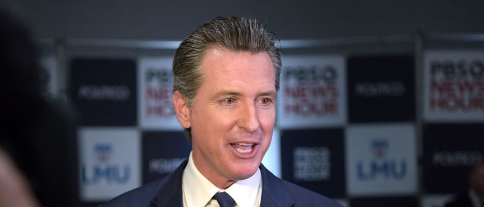 California Governor Gavin Newsom speaks to the press in the spin room after the sixth Democratic primary debate of the 2020 presidential campaign season co-hosted by PBS NewsHour & Politico at Loyola Marymount University in Los Angeles, California on December 19, 2019. (Photo by Agustin Paullier/AFP via Getty Images)