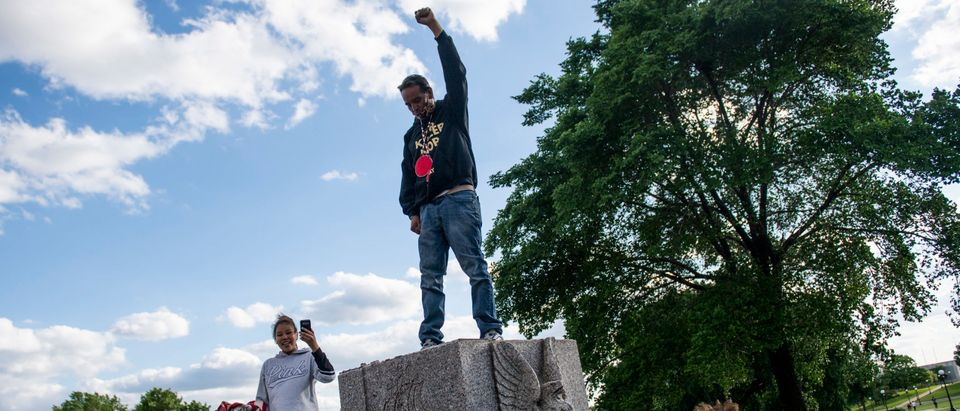 Protesters Tear Down Christopher Columbus Statue Outside Minnesota State Capitol