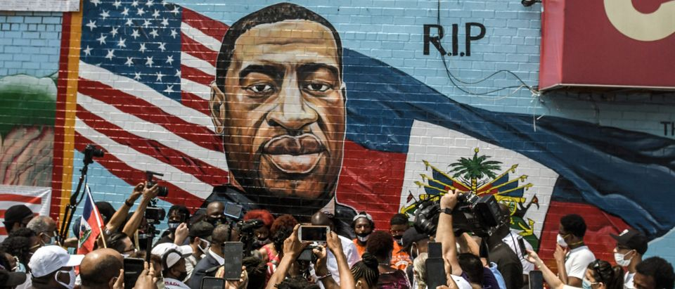 NEW YORK, NY - JULY 13: A mural painted by artist Kenny Altidor depicting George Floyd is unveiled on a sidewall of CTown Supermarket on July 13, 2020 in the Brooklyn borough New York City. George Floyd was killed by a white police officer in Minneapolis and his death has sparked a national reckoning about race and policing in the United States. (Stephanie Keith/Getty Images)