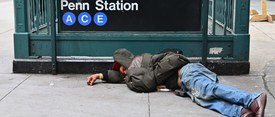 A man sleeps near Penn Station by Madison Square Gardens on September 17, 2020 in New York City. (ANGELA WEISS/AFP via Getty Images)