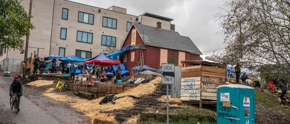 Protesters build defensive structures around the Red House on Mississippi on December 9, 2020 in Portland, Oregon. (Nathan Howard/Getty Images)