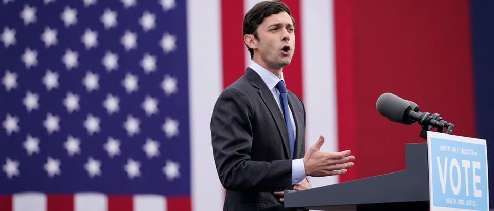 ATLANTA, GA - DECEMBER 15: U.S. Democratic Senate candidate Jon Ossoff delivers remarks during a campaign rally with U.S. President-elect Joe Biden at Pullman Yard on December 15, 2020 in Atlanta, Georgia. Biden's stop in Georgia comes less than a month before the January 5 runoff election for Ossoff and Warnock as they try to unseat Republican incumbents Sen. David Perdue and Sen. Kelly Loeffler.  (Drew Angerer/Getty Images)