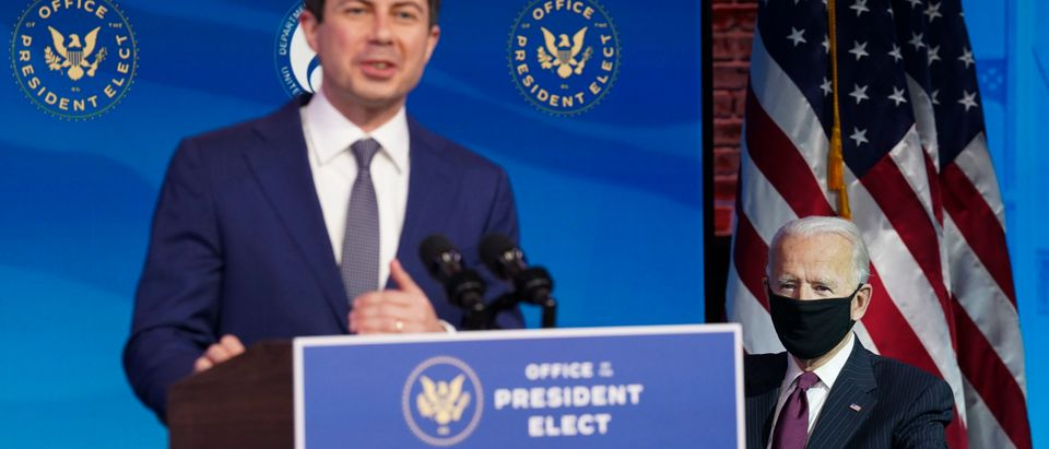 WILMINGTON, DELAWARE - DECEMBER 16: U.S. President-elect Joe Biden (R) looks on as former Democratic presidential candidate Pete Buttigieg speaks after he was nominated to be Secretary of Transportation during a news conference at Biden's transition headquarters on December 16, 2020 in Wilmington, Delaware. (Kevin Lamarque-Pool/Getty Images)