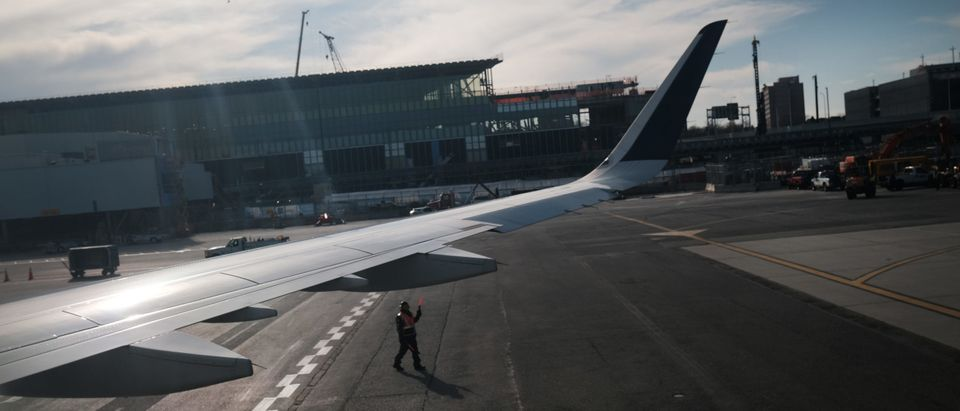 Travelers Move Through LaGuardia Airport As Pandemic Continues