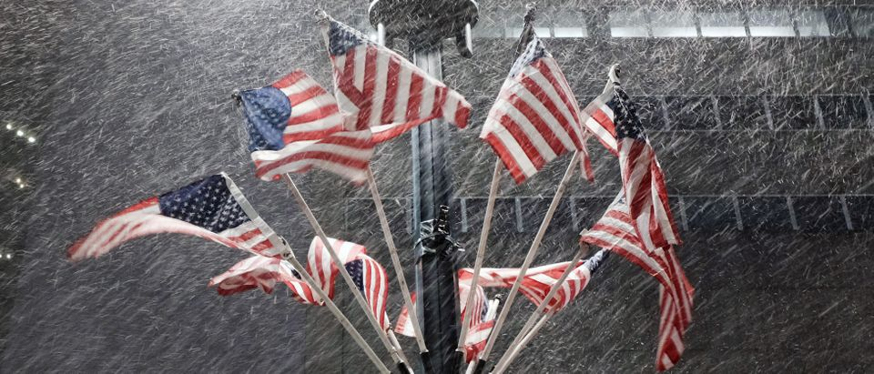 American Flags blow in the snow on December 17, 2020 in New York City, United States. (Spencer Platt/Getty Images)