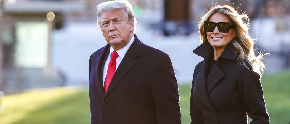 WASHINGTON, DC - DECEMBER 23: President Donald Trump and first lady Melania Trump walk on the south lawn of the White House on December 23, 2020 in Washington, DC. The Trumps are headed to Mar-a-Lago for the holidays with a government shutdown possible on Monday December 28. (Tasos Katopodis/Getty Images)