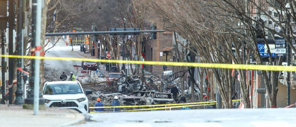 NASHVILLE, TENNESSEE - DECEMBER 25: Police close off an area damaged by an explosion on Christmas morning on December 25, 2020 in Nashville, Tennessee. A Hazardous Devices Unit was en route to check on a recreational vehicle which then exploded, extensively damaging some nearby buildings. According to reports, the police believe the explosion to be intentional, with at least 3 injured and human remains found in the vicinity of the explosion. (Terry Wyatt/Getty Images)