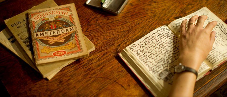 The waxwork representing Anne Frank writing