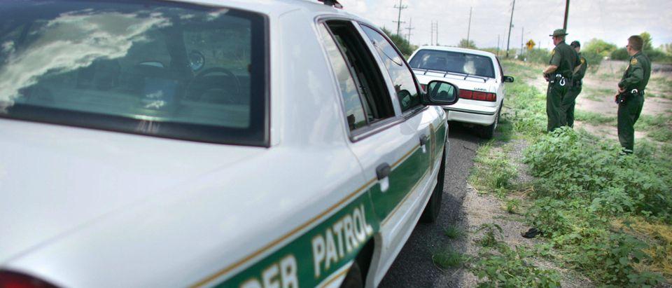 Border Patrol Agents question a driver a