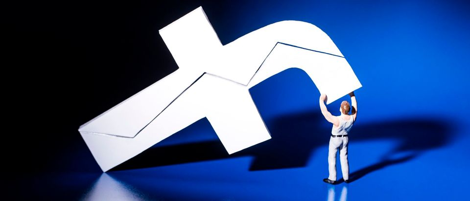 This photograph taken on May 16, 2018, shows a figurine carrying the logo of social network Facebook in Paris. (Photo by Joel Saget/AFP via Getty Images)
