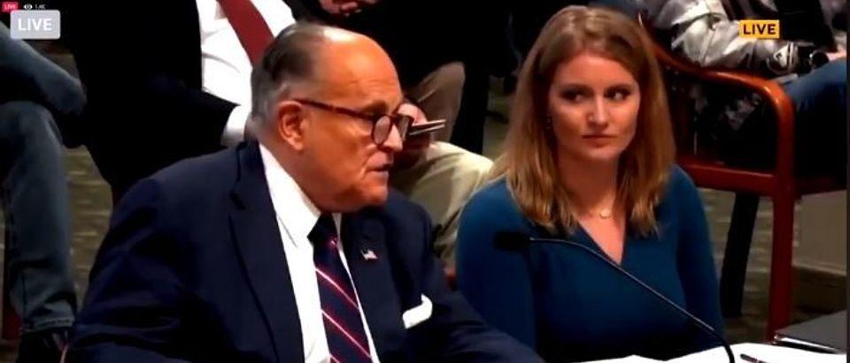 Jenna Ellis looks on as Rudy speaks (Twitter screengrab)