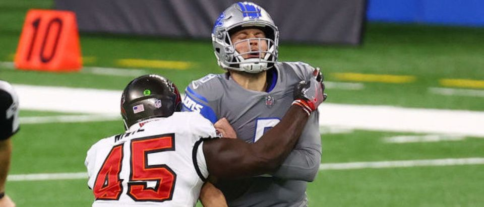 DETROIT, MICHIGAN - DECEMBER 26: Matthew Stafford #9 of the Detroit Lions under pressure from Devin White #45 of the Tampa Bay Buccaneers during the first quarter of a game at Ford Field on December 26, 2020 in Detroit, Michigan. (Photo by Rey Del Rio/Getty Images)