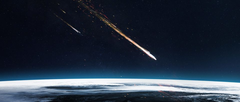 Meteor shower. Elements of this image furnished by NASA. Not affiliated with meteor in this story. By Vadim Sadovski. Shutterstock