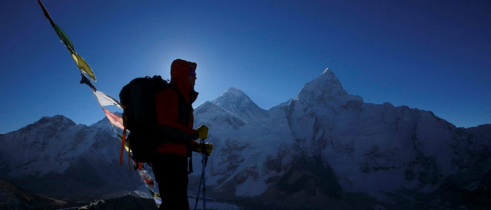 A trekker stands in front of Mount Everest at Kala Patthar in Solukhumbu District