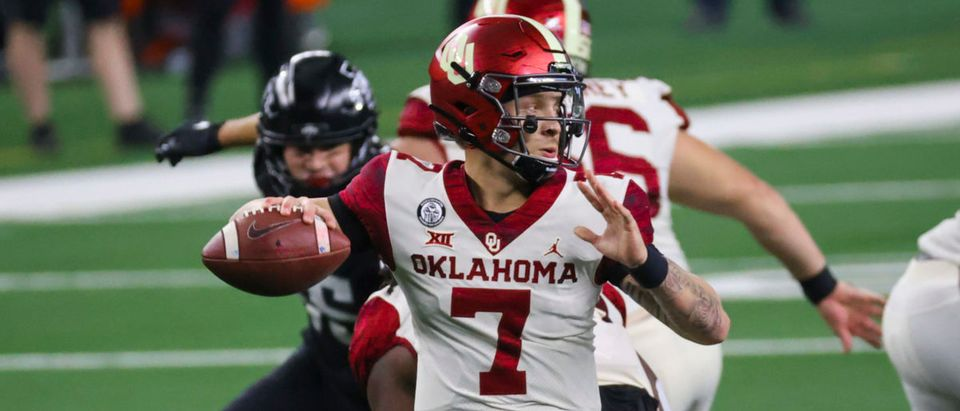 Dec 19, 2020; Arlington, Texas, USA; Oklahoma Sooners quarterback Spencer Rattler (7) throws during the first half against the Iowa State Cyclones at AT&T Stadium. Mandatory Credit: Kevin Jairaj-USA TODAY Sports via Reuters