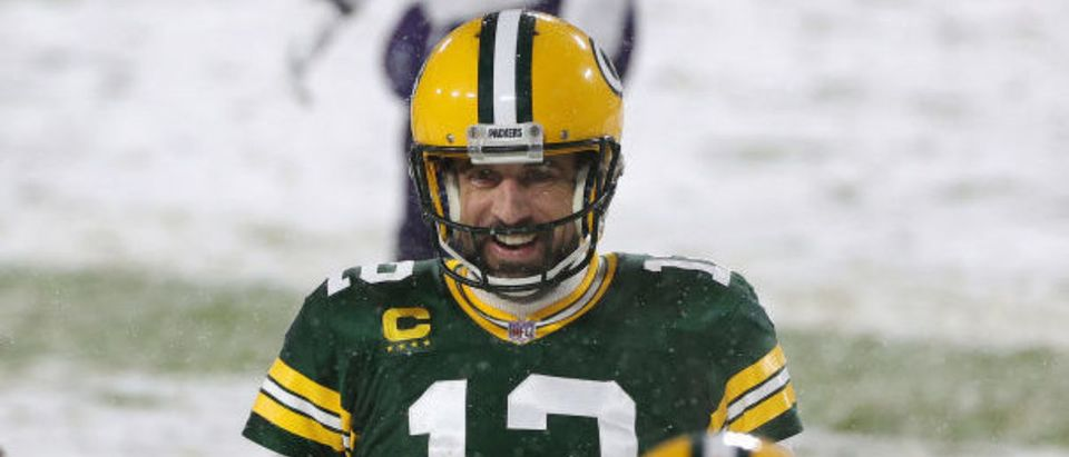 GREEN BAY, WISCONSIN - DECEMBER 27: Quarterback Aaron Rodgers #12 of the Green Bay Packers celebrates a touchdown pass to Equanimeous St. Brown #19 against the Tennessee Titans during the second quarter at Lambeau Field on December 27, 2020 in Green Bay, Wisconsin. (Photo by Stacy Revere/Getty Images)