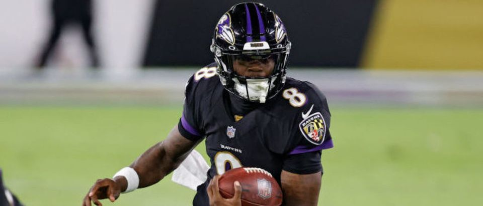 BALTIMORE, MARYLAND - DECEMBER 08: Quarterback Lamar Jackson #8 of the Baltimore Ravens rushes for a touchdown against the Dallas Cowboys during the first quarter at M&T Bank Stadium on December 8, 2020 in Baltimore, Maryland. (Photo by Tim Nwachukwu/Getty Images)