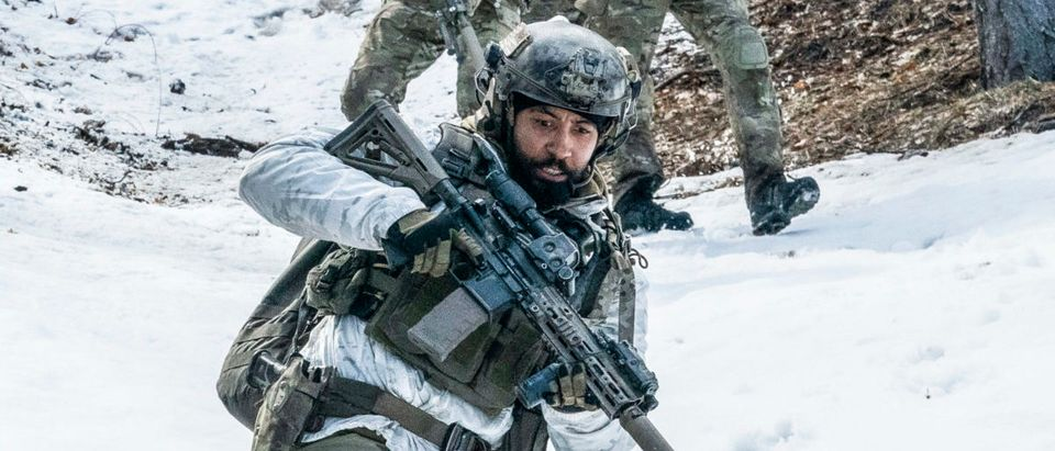 """""""God of War"""" – Bravo Team enters enemy territory in the snowy Spin Ghar Mountain Range to capture Al-Hazred, the leader of a terrorist group and son of the terrorist leader that Jason took down early in his career, and made him Bravo One. When they are attacked, Jason and Cerberus, Bravo's canine member, are separated from the team, in part one of the two-part fourth season premiere of SEAL TEAM, Wednesday, Nov. 25 (9:00-10:00 PM, ET/PT) on the CBS Television Network. The dramatic season premiere was directed by Bravo One himself, David Boreanaz. Pictured L to R: AJ Buckley as Sonny Quinn, Tyler Grey as Trent Sawyer, Justin Melnick as Brock Reynolds, Max Thieriot as Clay Spenser, and Neil Brown Jr. as Ray Perry. Photo: Erik Voake/CBS ©2020 CBS Broadcasting, Inc. All Rights Reserved."""