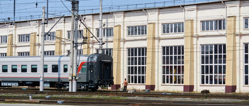 Shunting work with passenger cars against the background of a depot building. Train and shunting work not related to this story. By Evgeny Haritonov. Shutterstock