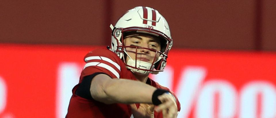 Dec 19, 2020; Madison, Wisconsin, USA; Wisconsin Badgers quarterback Graham Mertz (5) throws a pass during the game with the Minnesota Golden Gophers in the first half at Camp Randall Stadium. Mandatory Credit: Mary Langenfeld-USA TODAY Sports via Reuters