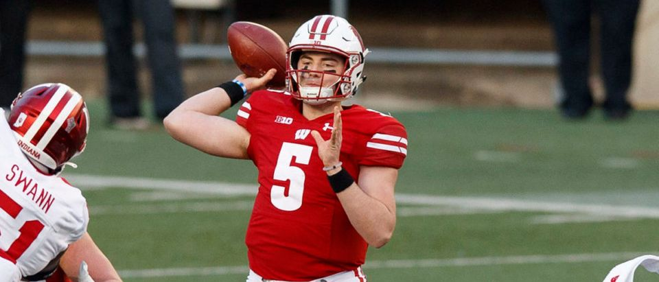 Dec 5, 2020; Madison, Wisconsin, USA; Wisconsin Badgers quarterback Graham Mertz (5) throws a pass during the second quarter against the Indiana Hoosiers at Camp Randall Stadium. Mandatory Credit: Jeff Hanisch-USA TODAY Sports via Reuters
