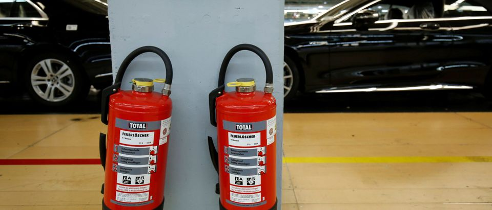 Fire extinguishers are pictured at the Mercedes S-Class (S-Klasse) production line at the Mercedes Benz factory in Sindelfingen