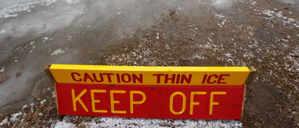 A thin ice warning is posted at White's Pond in Concord, New Hampshire