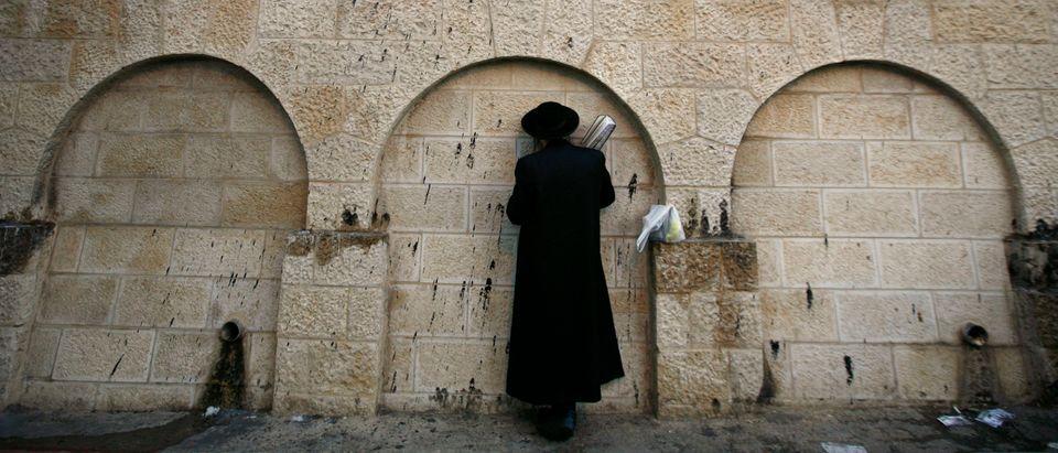 Orthodox Jewish man prays