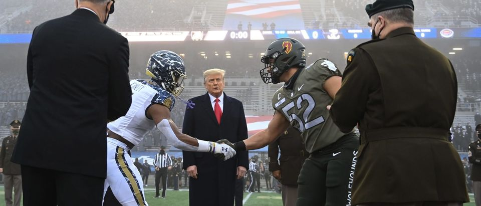 US President Donald Trump looks on after tossing the coin during the Army-Navy football game at Michie Stadium on December 12, 2020 in West Point, New York. (Photo by Brendan SMIALOWSKI / AFP) (Photo by BRENDAN SMIALOWSKI/AFP via Getty Images)