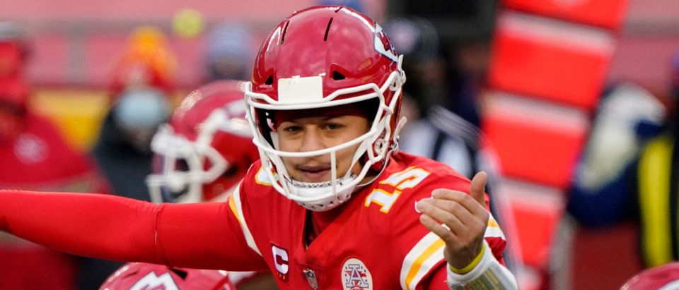 Jan 17, 2021; Kansas City, Missouri, USA; Kansas City Chiefs quarterback Patrick Mahomes (15) before the snap against the Cleveland Browns during the second half in the AFC Divisional Round playoff game at Arrowhead Stadium. Mandatory Credit: Jay Biggerstaff-USA TODAY Sports via Reuters