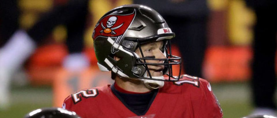 LANDOVER, MARYLAND - JANUARY 09: Quarterback Tom Brady #12 of the Tampa Bay Buccaneers looks to pass against the Washington Football Team during the first half of the NFC Wild Card playoff game at FedExField on January 09, 2021 in Landover, Maryland. (Photo by Rob Carr/Getty Images)