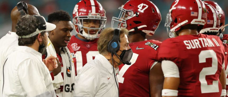 MIAMI GARDENS, FLORIDA - JANUARY 11: Head coach Nick Saban of the Alabama Crimson Tide talks to his players during the fourth quarter of the College Football Playoff National Championship game against the Ohio State Buckeyes at Hard Rock Stadium on January 11, 2021 in Miami Gardens, Florida. (Photo by Kevin C. Cox/Getty Images)