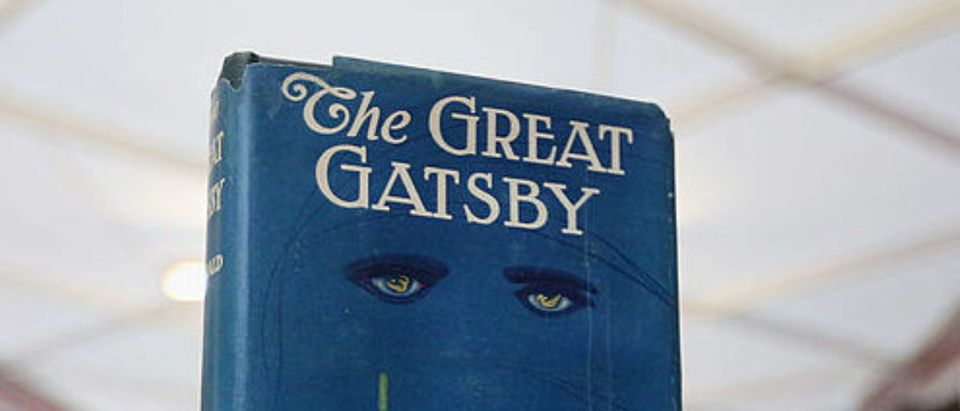 LONDON, ENGLAND - JUNE 13: A first edition of F Scott Fitzgerald's 'The Great Gatsby' at the London International Antiquarian Book Fair in the Olympia exhibition centre on June 13, 2013 in London, England. The Antiquarian Booksellers' Association was founded in 1906 and their book fair is the oldest in the UK having run for 56 years. It attracts approximately 200 book dealers from around the world, selling fascinating and rare books, maps, prints and manuscripts. (Photo by Oli Scarff/Getty Images)