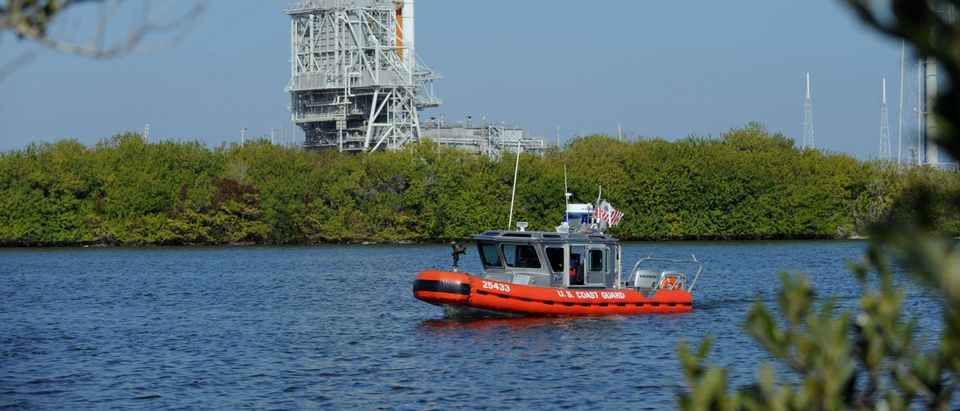 A US Coast Guard boat patrols waters nea