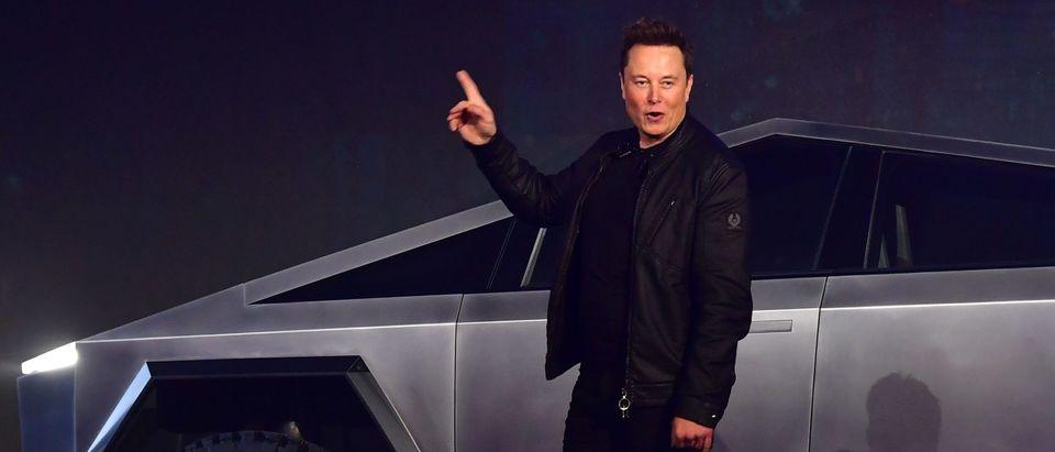 Elon Musk Stands In Front Of Tesla Cybertruck
