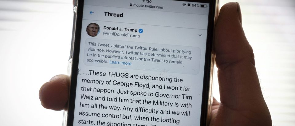 The twitter page of US President Donald Trump's is displayed on a mobile phone in Vaasa, Finland, on May 29, 2020. - Twitter on May 29, 2020 flagged a post by US President Donald Trump on the unrest in Minneapolis as 'glorifying violence', saying the tweet violated its rules but would not be removed. (Photo by Olivier Morin/AFP via Getty Images)