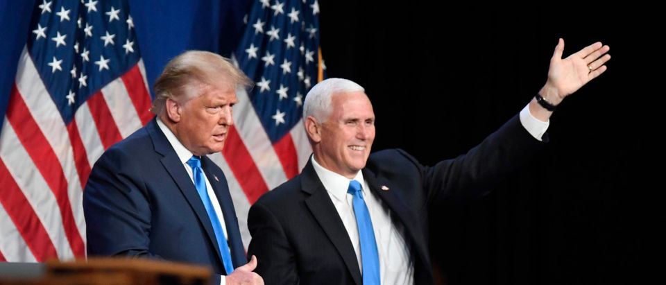 President Donald J. Trump and Vice President Mike Pence greet delegates on the first day of the Republican National Convention at the Charlotte Convention Center on August 24, 2020 in Charlotte, North Carolina. (David T. Foster III-Pool/Getty Images)