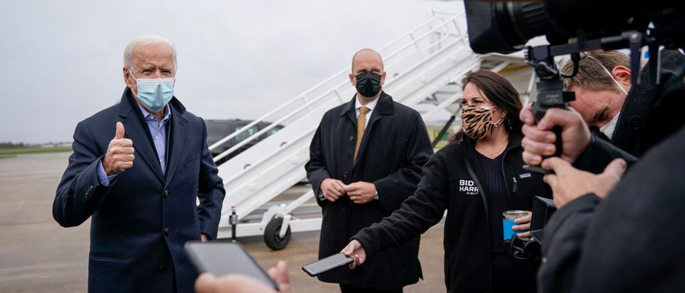 Democratic presidential nominee Joe Biden speaks to reporters before boarding his campaign plane at New Castle Airport on October 30, 2020 in New Castle, Delaware. (Drew Angerer/Getty Images)