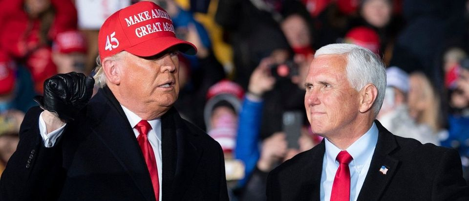 US President Donald Trump arrives with US Vice President Mike Pence for a Make America Great Again rally at Cherry Capital Airport in Traverse City, Michigan on November 2, 2020. (Photo by BRENDAN SMIALOWSKI/AFP via Getty Images)