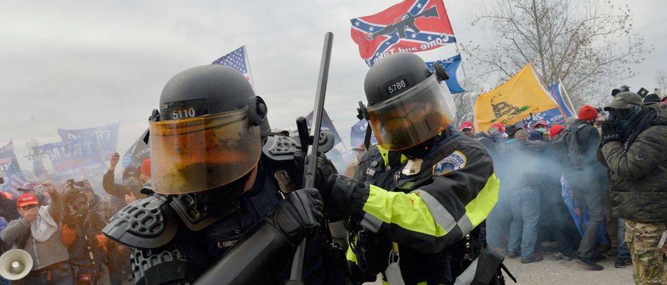Trump supporters clash with police and security forces as they try to storm the US Capitol in Washington, DC on January 6, 2021. - Demonstrators breeched security and entered the Capitol as Congress debated the a 2020 presidential election Electoral Vote Certification. (Photo by Joseph Prezioso/AFP via Getty Images)