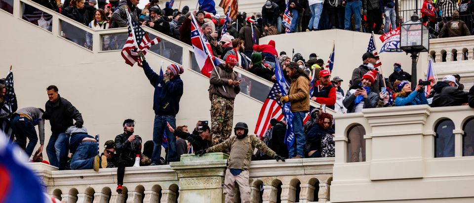 WASHINGTON, DC - JANUARY 06: Pro-Trump supporters storm the U.S. Capitol following a rally with President Donald Trump on January 6, 2021 in Washington, DC. Trump supporters gathered in the nation's capital today to protest the ratification of President-elect Joe Biden's Electoral College victory over President Trump in the 2020 election. (Samuel Corum/Getty Images)