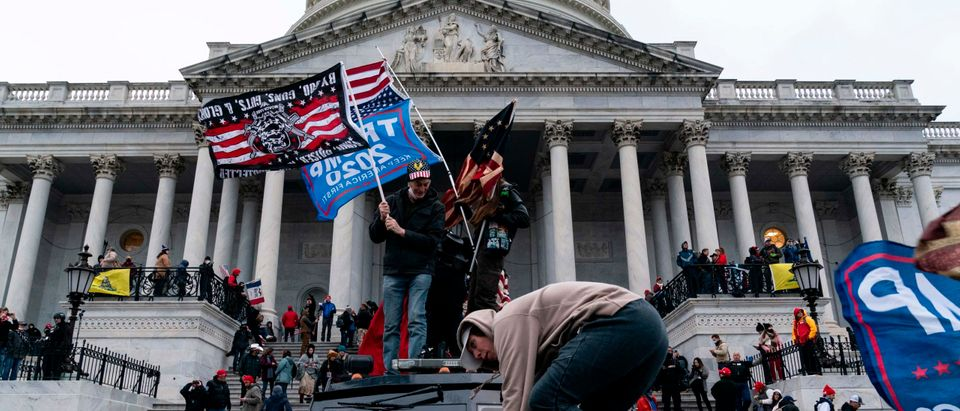 Supporters of US President Donald Trump protest outside the US Capitol on January 6, 2021, in Washington, DC. - Demonstrators breeched security and entered the Capitol as Congress debated the a 2020 presidential election Electoral Vote Certification. (Photo by Alex Edelman/AFP via Getty Images)