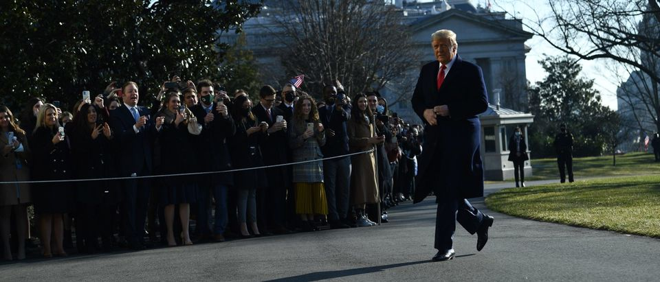 US President Donald Trump walks by supporters outside the White House on January 12, 2021 in Washington,DC before his departure to Alamo, Texas. (Photo by BRENDAN SMIALOWSKI/AFP via Getty Images)
