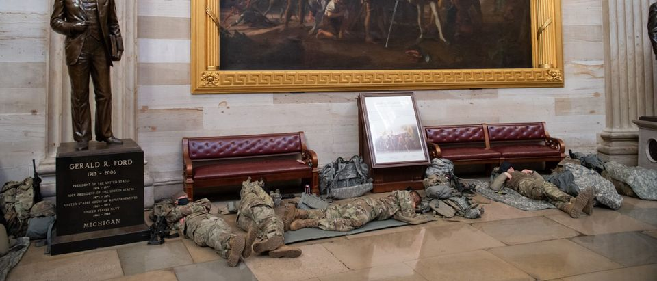 Members of the National Guard take a rest in the Rotunda of the US Capitol in Washington, DC, January 13, 2021, ahead of an expected House vote impeaching US President Donald Trump. - The Democrat-controlled US House of Representatives on Wednesday opened debate on a historic second impeachment of President Donald Trump over his supporters' attack of the Capitol that left five dead.Lawmakers in the lower chamber are expected to vote for impeachment around 3:00 pm (2000 GMT) -- marking the formal opening of proceedings against Trump. (Photo by Saul Loeb/AFP via Getty Images)