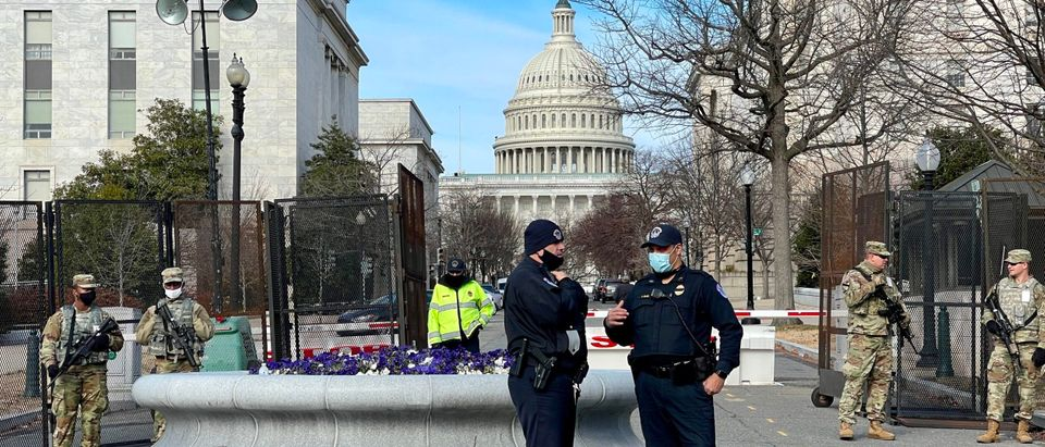 Members of the US National Guard an police officers patrol near the US Capitol in Washington, DC on January 16, 2021, as preparations are made for the inauguration of Joe Biden as the 46th US President. (DANIEL SLIM/AFP via Getty Images)