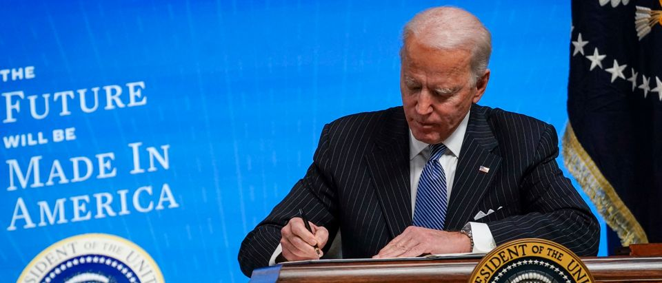 U.S. President Joe Biden signs an executive order related to American manufacturing in the South Court Auditorium of the White House complex on January 25, 2021 in Washington, DC. (Drew Angerer/Getty Images)