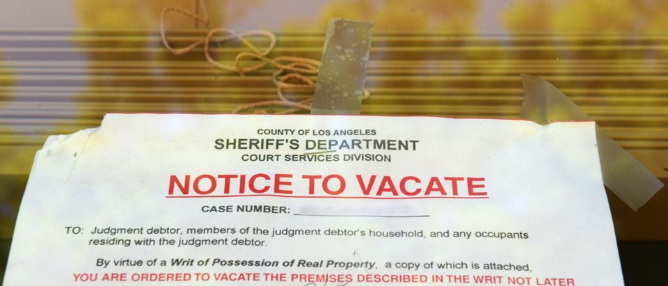 """A """"Notice to Vacate"""" is seen in the wind"""